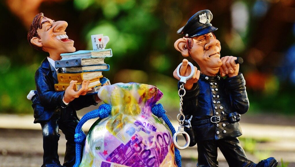 Taxes Tax Evasion Police Handcuffs Scam
